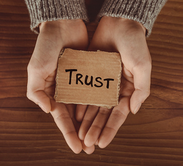 hands holding sign with trust for reviews