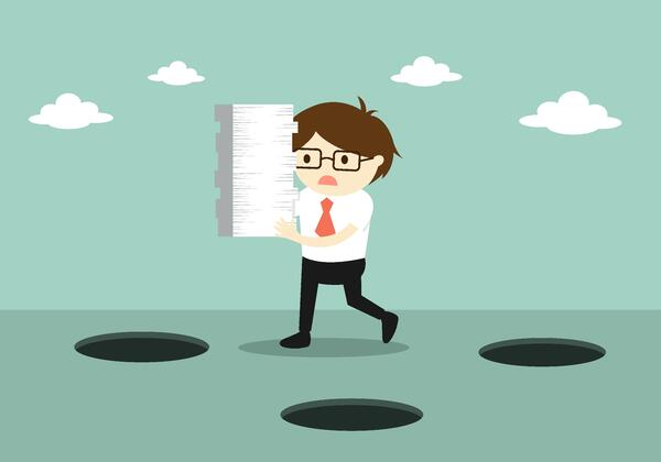 man working in a field service business like plumbing and gas business is overwhelmed by paperwork and does not know how to avoid paperwork mistakes