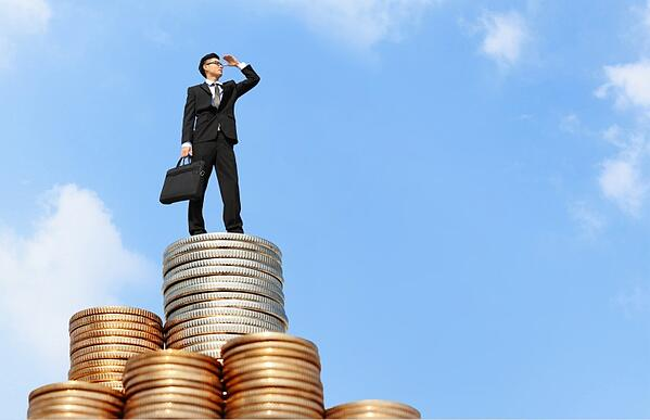 man standing on top of profit made by the best parts management system