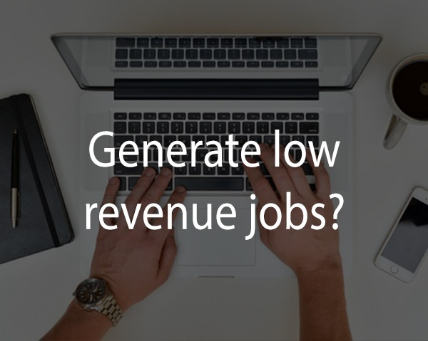 Man types on a laptop a search related to how to generate low revenue jobs