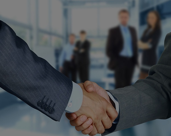 Two man shaking hands over a successful service partnership