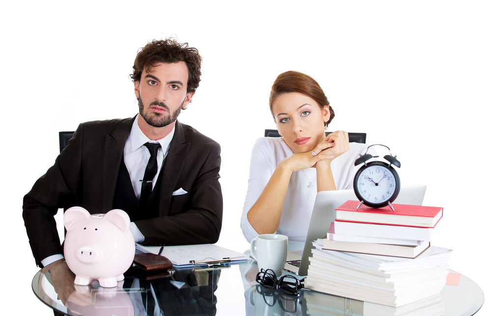 Closeup portrait of young couple, sad man, unhappy woman, looking distressed from financial problems, mounting bills, isolated on white background. Bad finance decision, bankruptcy. Bank mistake