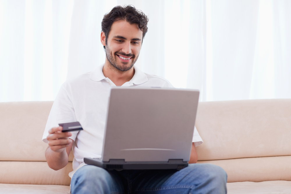 Man buying online in his living room