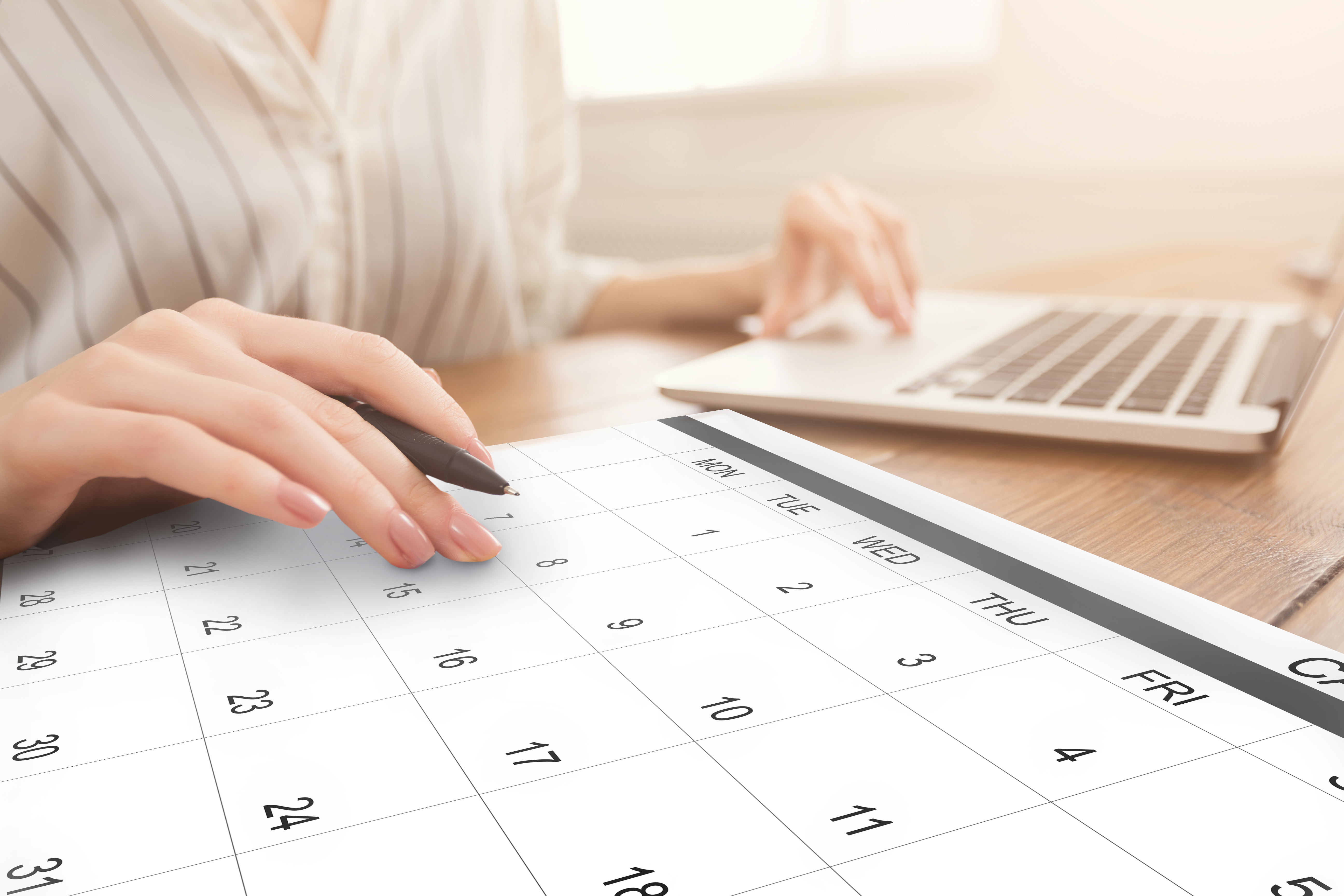 business-scheduling-unrecognizable-woman-working-o-C64Z6NR