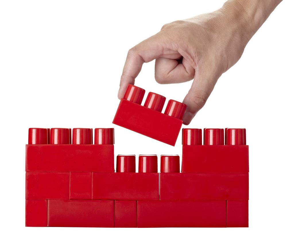 close up of child toy bricks construction on white background
