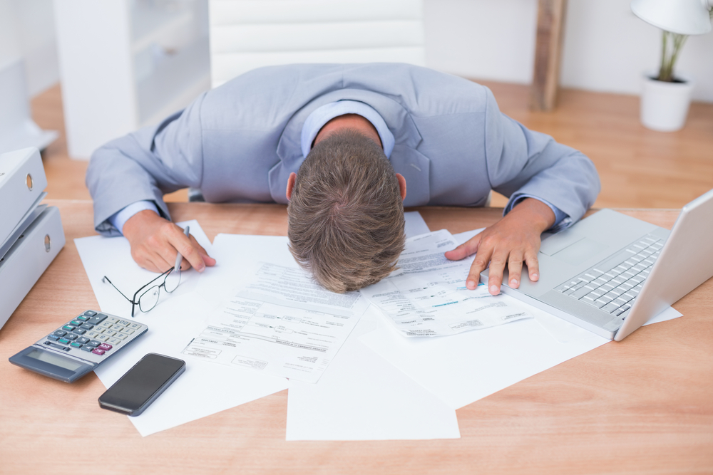 Businessman being depressed by accounting and dealing with difficult clients