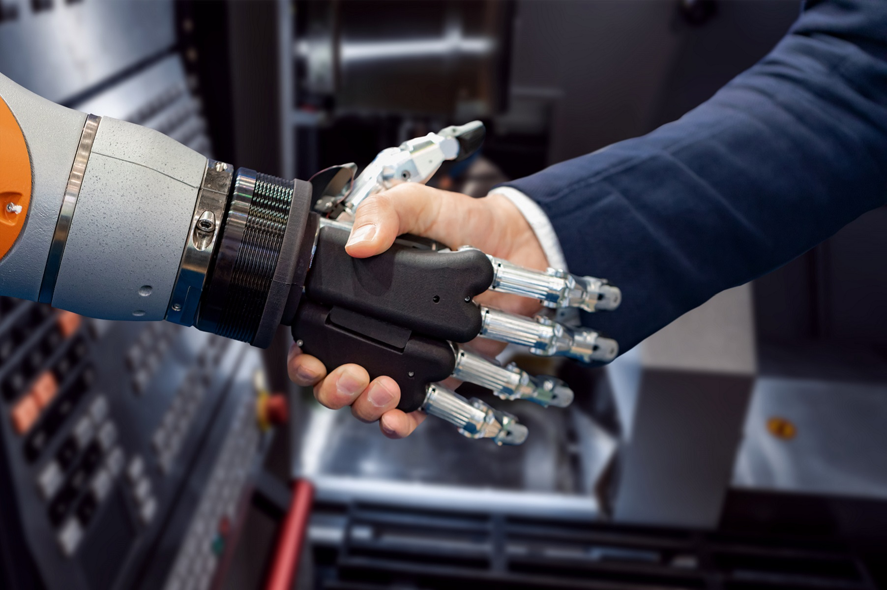 hand-of-a-businessman-shaking-hands-with-an-android-robot-automation