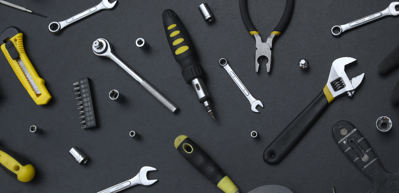 handyman-tool-kit-on-black-wooden-table-many-wren-2021-04-06-19-29-17-utc